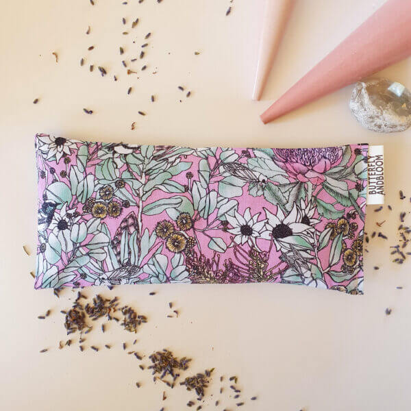 Mint refresh eye pillow for headaches in a floral pink fabric on a white background
