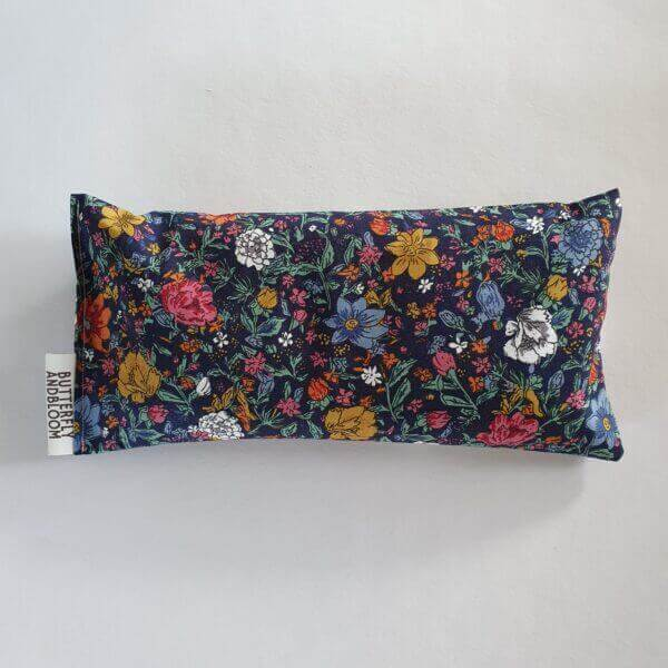 flowers on a dark blue background fabric on Lavender Aromatherapy Eye Pillows on a white background