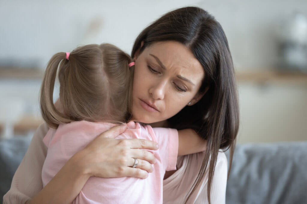 woman comforting small child