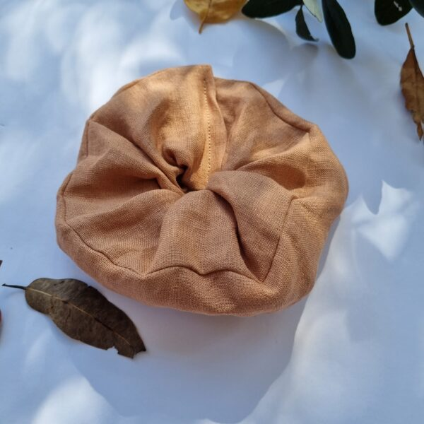 Handmade hair scrunchie with naturally dyed hemp fabric in a blush colour